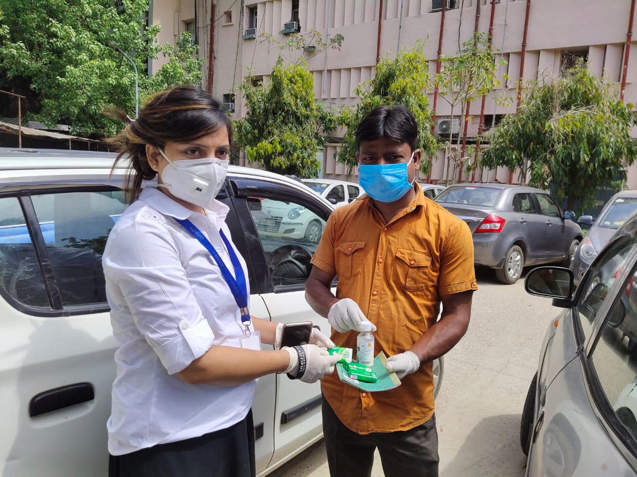 One of our outreach workers distributing hygiene product.