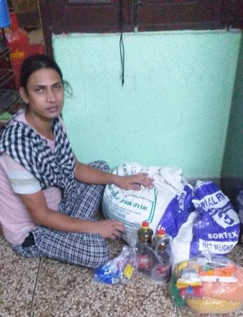 A member of Basera Samajik Sansthan packing dry food ration for distribution